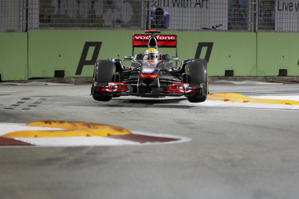 Lewis Hamilton, McLaren MP4-26 Mercedes, gets airborne at the Singapore Sling.