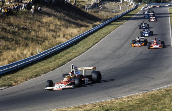 Emerson Fittipaldi, McLaren M23 Ford leads Clay Regazzoni, Ferrari 312B3 and John Watson, Brabham BT44 Ford.