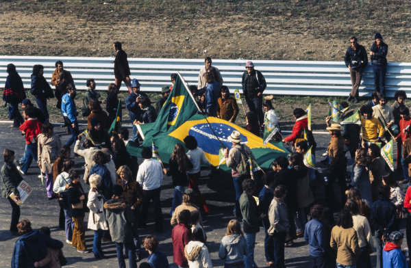 Brazilian fans take to the track.
