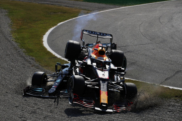 Sir Lewis Hamilton, Mercedes W12, and Max Verstappen, Red Bull Racing RB16B, crash out of the race