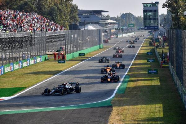 Valtteri Bottas, Mercedes W12, leads Max Verstappen, Red Bull Racing RB16B, Daniel Ricciardo, McLaren MCL35M, Lando Norris, McLaren MCL35M, and the rest of the field at the start