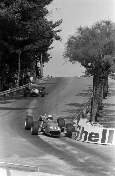 Lorenzo Bandini, Ferrari 312, leads John Surtees, Honda RA273, at the chicane.