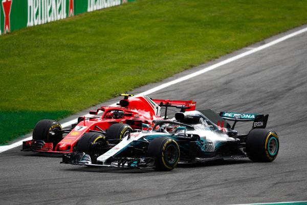 Lewis Hamilton, Mercedes AMG F1 W09, passes Kimi Raikkonen, Ferrari SF71H.