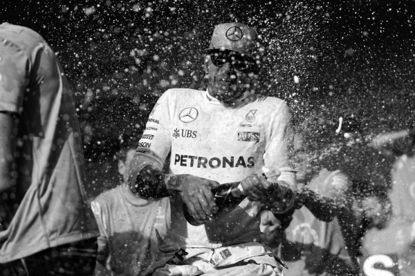 Race winner Lewis Hamilton (GBR) Mercedes AMG F1 celebrates with the team and the champagne at Formula One World Championship, Rd18, United States Grand Prix, Race, Circuit of the Americas, Austin, Texas, USA, Sunday 23 October 2016.