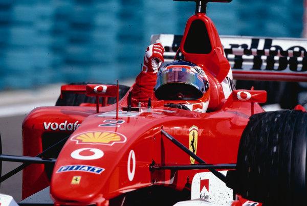 2002 Hungarian Grand Prix. Hungaroring, Budapest, Hungary.  16-18 August 2002. Rubens Barrichello (Ferrari F2002) celebrates his 1st position. Ref-02 HUN 31. World Copyright - Tee/LAT Photographic