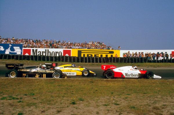 Zandvoort, Holland.24-26 August 1984.Alain Prost (McLaren MP4\2 TAG Porsche) leads Derek Warwick (Renault RE50) and Elio de Angelis (Lotus 95T Renault).Ref-84 HOL 07.World Copyright - LAT Photographic