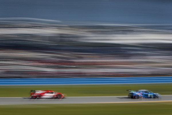 #57 Heinricher Racing w/MSR Curb-Agajanian Acura NSX GT3, GTD: Alvaro Parente, Misha Goikhberg, Trent Hindman, AJ Allmendinger, #31 Whelen Engineering Racing Cadillac DPi, DPi: Filipe Albuquerque, Pipo Derani, Mike Conway, Felipe Nasr