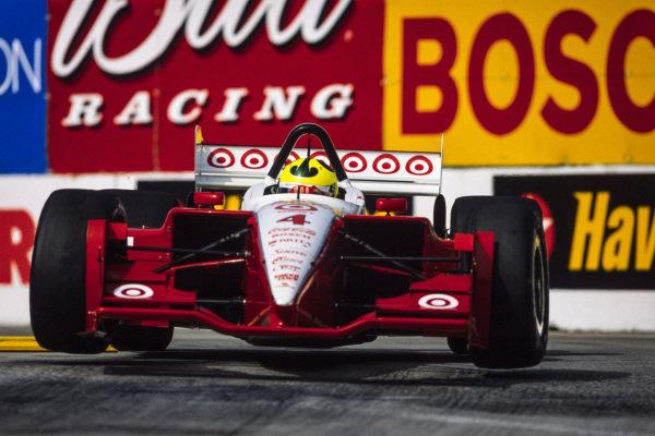 Bruno Junqueira, Chip Ganassi Racing, Lola B02/00 Toyota, gets airborne.