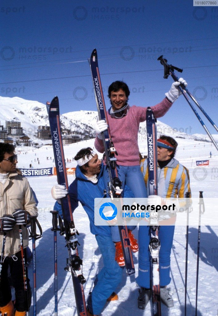 Kitzbuhel, Austria. 1983. Riccardo Patrese in hoisted into the air by fellow skiers on the slopes. Michele Alboreto looks on