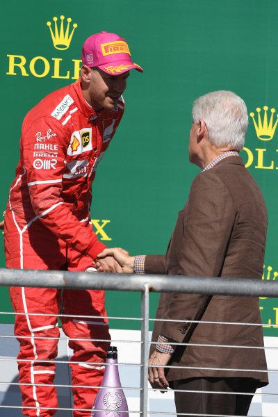 Sebastian Vettel (GER) Ferrari on the podium with Bill Clinton (USA) at Formula One World Championship, Rd17, United States Grand Prix, Race, Circuit of the Americas, Austin, Texas, USA, Sunday 22 October 2017.