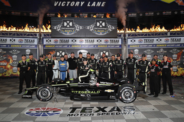 Josef Newgarden, Team Penske Chevrolet celebrates with  his team in victory lane