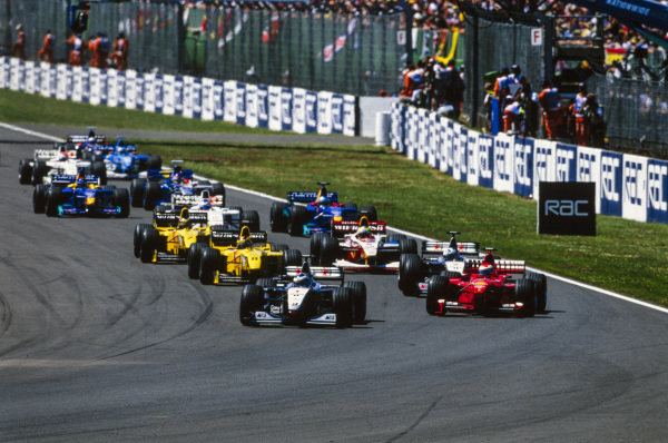 Mika Häkkinen, McLaren MP4-14 Mercedes, leads Eddie Irvine, Ferrari F399, David Coulthard, McLaren MP4-14 Mercedes, Heinz-Harald Frentzen, Jordan 199 Mugen-Honda, Ralf Schumacher, Williams FW21 Supertec, Damon Hill, Jordan 199 Mugen-Honda, and the rest of the field at the start of the race.