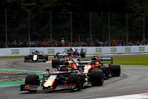 Alexander Albon, Red Bull RB15, leads Carlos Sainz Jr., McLaren MCL34, Antonio Giovinazzi, Alfa Romeo Racing C38, and Kevin Magnussen, Haas VF-19