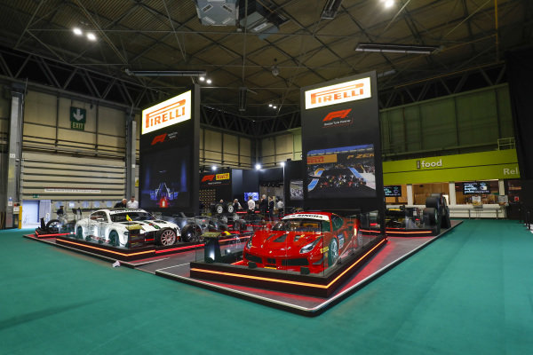 Ferrari and Bentley GT cars on the Pirelli stand.