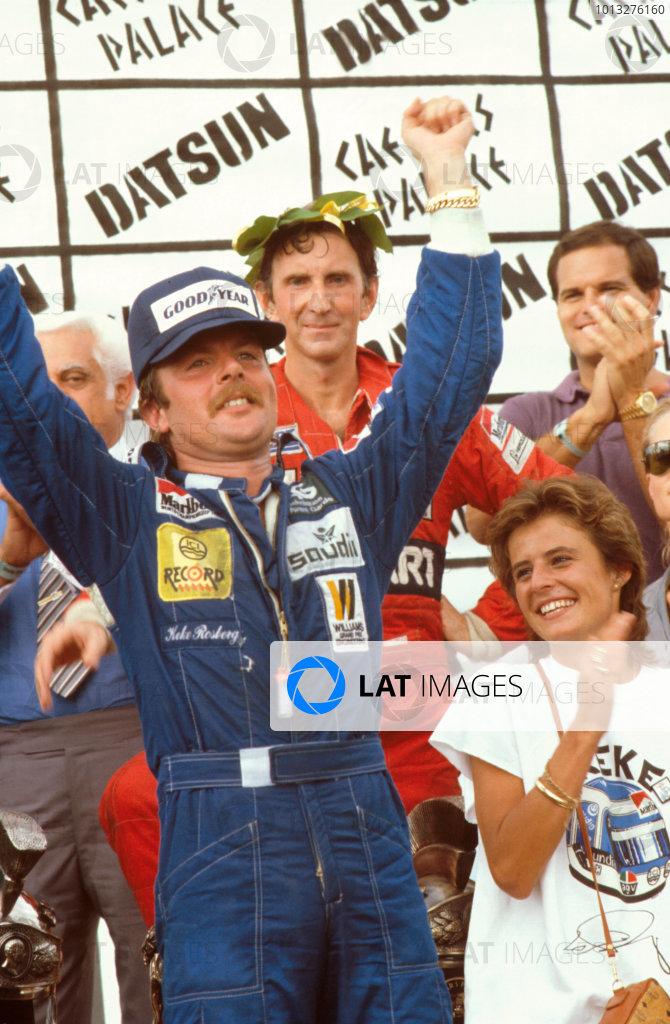 Las Vegas, Nevada, USA.23-25 September 1982.The new World Champion Keke Rosberg celebrates on the podium with wife. John Watson, 2nd position behind.Ref-82 LV 03.World Copyright - LAT Photographic