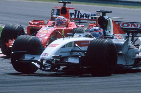 2005 Hungarian Grand Prix. Hungaroring, Hungary. 29th - 31st July 2005 Takuma Sato, BAR Honda 007 and Rubens Barrichello, Ferrari F2005 battle for position. Action. World Copyright: Charles Coates/LAT Photographic Ref: 35mm Image A23