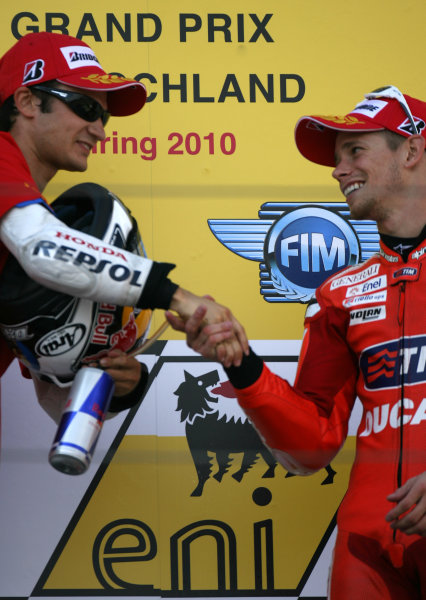 Germany Sachsenring 16-18 July 2010Race winner Dani Pedrosa is congratulated by Casey Stoner