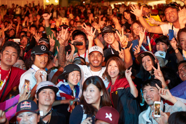 Suzuka Circuit, Japan. Saturday 7 October 2017. Lewis Hamilton, Mercedes AMG, joins a huge gathering of fans. World Copyright: Steve Etherington/LAT Images  ref: Digital Image SNE15402