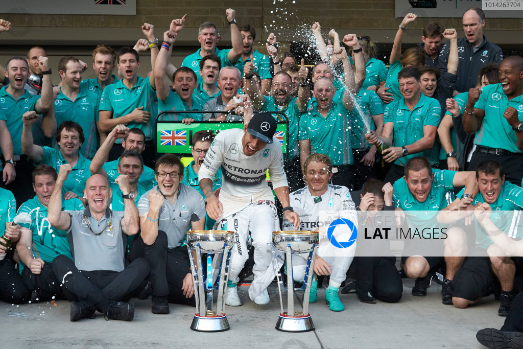 Circuit of the Americas, Austin, Texas, United States of America. Sunday 2 November 2014. Lewis Hamilton, Mercedes AMG celebrates with the team and Nico Rosberg, Mercedes AMG after winning the race. World Copyright: Steve Etherington/LAT Photographic. ref: Digital Image SNE25055