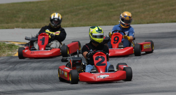 2003 Champ Car Series 1-3 August 2003Mario Andretti Grand Prix of Road AmericaElkhart Lake, Wi. Bruno Junqueira (#2) and Rodolfo Lavin(#3) with contest winner at speed on Road America's go kart track. 2003- Dan R. Boyd USA LAT Photographic
