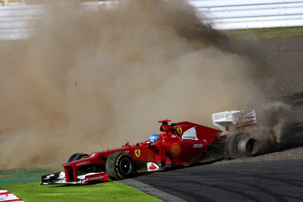 Suzuka Circuit, Suzuka, Japan.7th October 2012.Fernando Alonso, Ferrari F2012, spins in to retirement with a puncture to his left rear caused by contact in the opening corner of the race.World Copyright:Andy Hone/LAT Photographicref: Digital Image HONZ2634