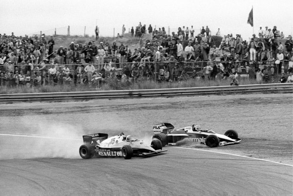 Nelson Piquet (BRA) Brabham BT52B (Right) heads into the tyre barrier at Tarzan after being hit by Alain Prost (FRA) Renault RE40 (Left) on lap 42 when Alain lost control whilst trying to overtake him. Piquet retired on the spot, Prost crashed out later that lap having suffered damage to the front wing. Dutch Grand Prix, Rd 12, Zandvoort, Holland, 28 August 1983.