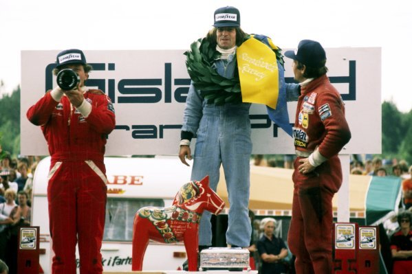 The podium (L to R): Jochen Mass (GER) McLaren, second; Jacques Laffite (FRA) Ligier, winner; Carlos Reutemann (ARG) Ferrari, third.Swedish Grand Prix, Rd 8, Anderstorp, Sweden, 19 June 1977.BEST IMAGE