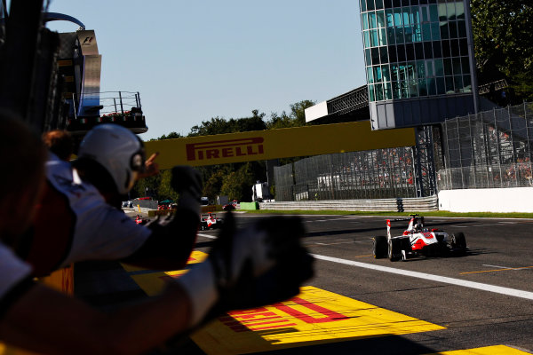 2015 GP3 Series Round 6. Autodromo Nazionale di Monza, Monza, Italy. Sunday 6 September 2015. Marvin Kirchhofer (GER, ART Grand Prix) takes the win as he drives past his team. World Copyright: Sam Bloxham/LAT Photographic. ref: Digital Image _G7C1830