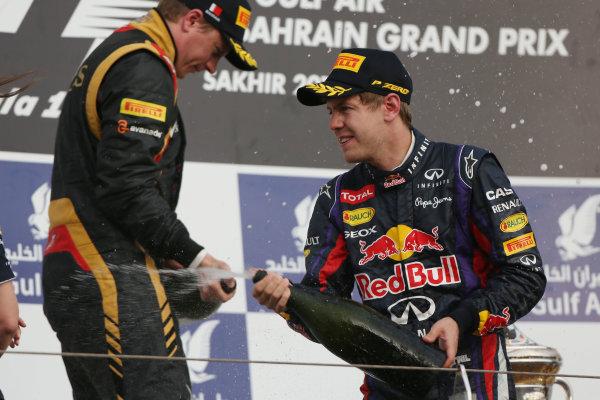 Bahrain International Circuit, Sakhir, Bahrain Sunday 21st April 2013 Sebastian Vettel, Red Bull Racing, 1st position, and Kimi Raikkonen, Lotus F1, 2nd position, spray Waard on the podium. World Copyright: Andy Hone/LAT Photographic ref: Digital Image HONZ3096