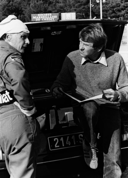 1982 French Grand Prix. Paul Ricard, France. 23rd - 25th July 1982. Niki Lauda (McLaren MP4/1B-Ford) with Tyler Alexander in the paddock, portrait.  World Copyright: LAT Photographic.