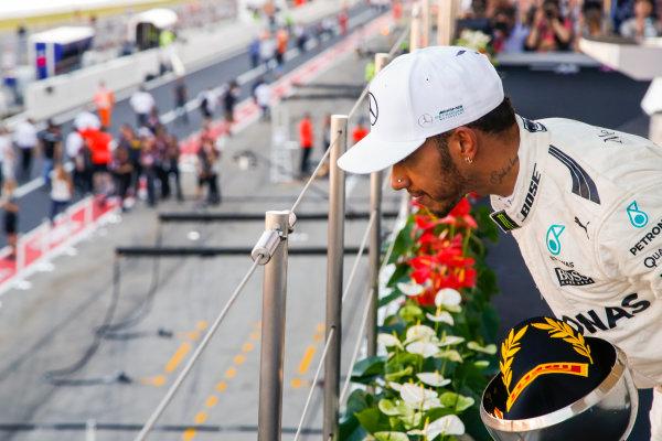 Suzuka Circuit, Japan. Sunday 8 October 2017. Lewis Hamilton, Mercedes AMG, 1st Position, on the podium. World Copyright: Joe Portlock/LAT Images  ref: Digital Image _L5R0427