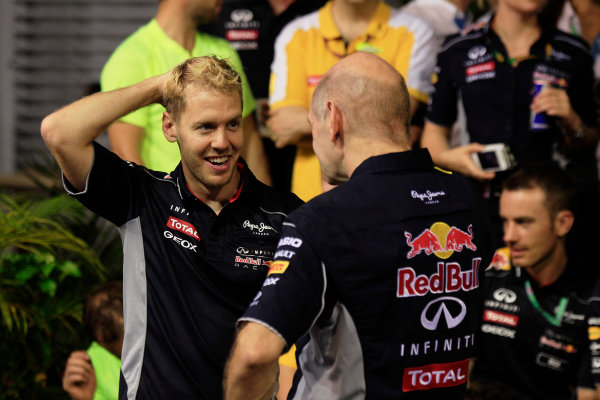 Marina Bay Circuit, Singapore. Sunday 22nd September 2013.  Sebastian Vettel and Adrian Newey, Red Bull Racing celebration team photo.  World Copyright: Charles Coates/LAT Photographic. ref: Digital Image _X5J0198