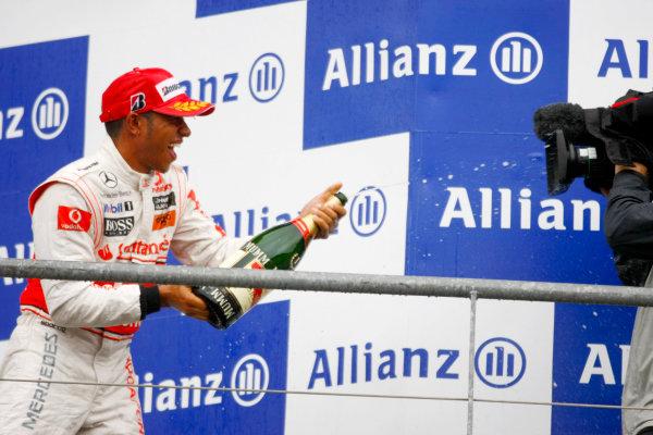 Spa-Francorchamps, Spa, Belgium 29th August 2010 Lewis Hamilton, McLaren MP4-25 Mercedes, 1st position, celebrates with Champagne on the podium. Portrait. Podium.  World Copyright: Charles Coates/LAT Photographic ref: Digital Image _26Y6845