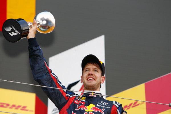 Suzuka Circuit, Suzuka, Japan.9th October 2011.Sebastian Vettel, Red Bull Racing RB7 Renault, 3rd position, lifts the trophy. Portrait. Podium. World Copyright:Glenn Dunbar/LAT Photographicref: Digital Image _G7C2514