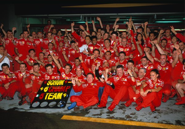 2003 Japanese Grand PrixSuzuka, Japan. 10th - 112th October 2003.The Ferrari team celebrate both Michael Schumacher's 6th World Championship victory and also clinching the Constructors title.World Copyright: Lorenzo Bellanca / LAT Photographic ref: 35mm Image 03JAP25