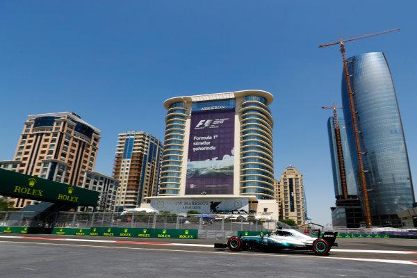 Baku City Circuit, Baku, Azerbaijan. Friday 23 June 2017. Lewis Hamilton, Mercedes F1 W08 EQ Power+, drives in front of the Baku skyline. World Copyright: Steven Tee/LAT Images ref: Digital Image _O3I0678