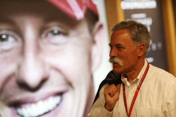 Red Bull Ring, Spielberg, Austria. Sunday 9 July 2017. Chase Carey, Chairman, Formula One, views a portrait of Michael Schumacher. World Copyright: Charles Coates/LAT Images ref: Digital Image AN7T3655