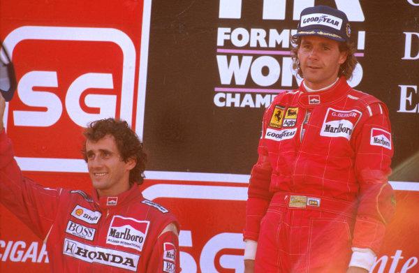 Estoril, Portugal.22-24 September 1989.Gerhard Berger (Ferrari) 1st position and Alain Prost (McLaren Honda) 2nd position on the podium.Ref-89 POR 01.World Copyright - LAT Photographic