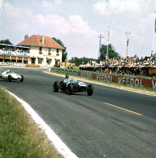 1958 Coupe Internationale de Vitesse. Reims, France. 6 July 1958. F2 race supporting the French Grand Prix. Graham Hill (Lotus 12-Climax) leads Tommy Bridger (Cooper T45-Climax). They finished in 13th and 8th positions respectively. Ref-3/0075. World Copyright - LAT Photographic
