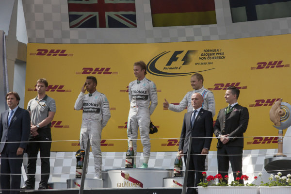 Race winner Nico Rosberg on the podium with Lewis Hamilton, 2nd position, and Valtteri Bottas, 3rd position.