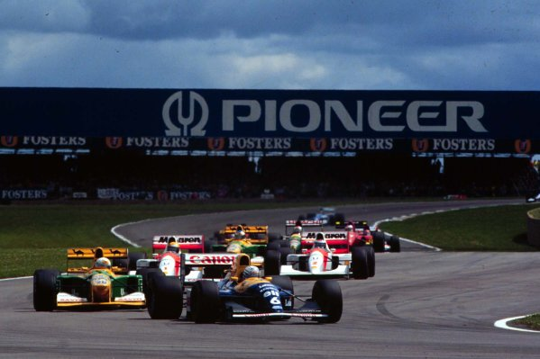 1992 British Grand Prix.Silverstone, England.10-12 July 1992.Riccardo Patrese (Williams FW14B Renault) leads the chasing pack. He finished in 2nd position.World Copyright - LAT Photographic
