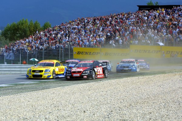 2002 DTM Championship A1 Ring, Austria. 7th - 8th September 2002. Christian Abt (Abt Audi) and Timo Schedier (Opel Team Holzer) battle for position.World Copyright: Andre Irlmeier/LAT Photographic