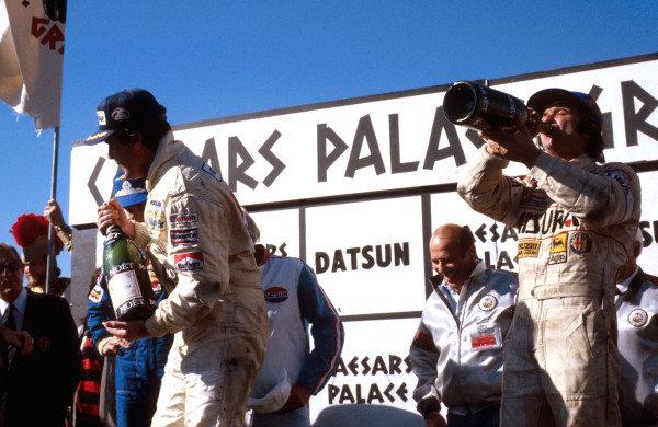 1981 Caesars Palace Grand Prix.Las Vegas, Nevada, USA.15-17 October 1981.Alan Jones (Williams Ford) 1st position and Bruno Giacomelli (Alfa Romeo) 3rd position on the podium.Ref-81 LV 07.World Copyright - LAT Photographic
