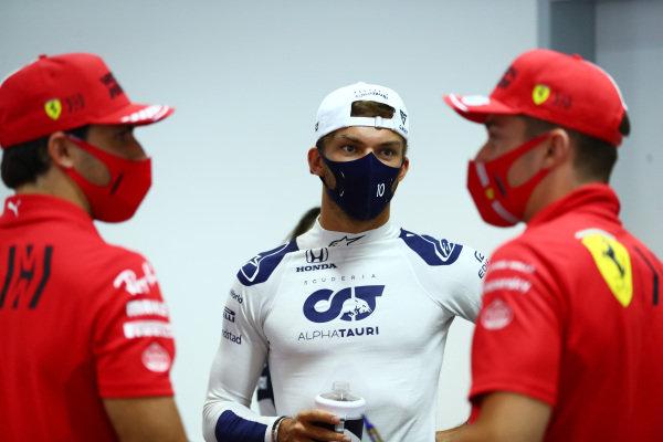 Carlos Sainz, Ferrari, Pierre Gasly, AlphaTauri, and Charles Leclerc, Ferrari