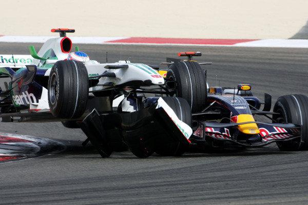 Jenson Button (GBR) Honda RA108 and David Coulthard (GBR) Red Bull Racing RB4 crash. Formula One World Championship, Rd 3, Bahrain Grand Prix, Race, Bahrain International Circuit, Bahrain, Sunday 6 April 2008.  BEST IMAGE
