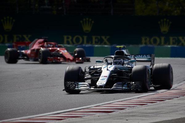 Valtteri Bottas, Mercedes AMG F1 W09, leads Sebastian Vettel, Ferrari SF71H.