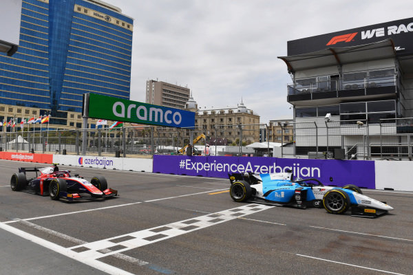 Richard Verschoor (NLD, MP Motorsport), leads Marino Sato (JPN, Trident) across the line