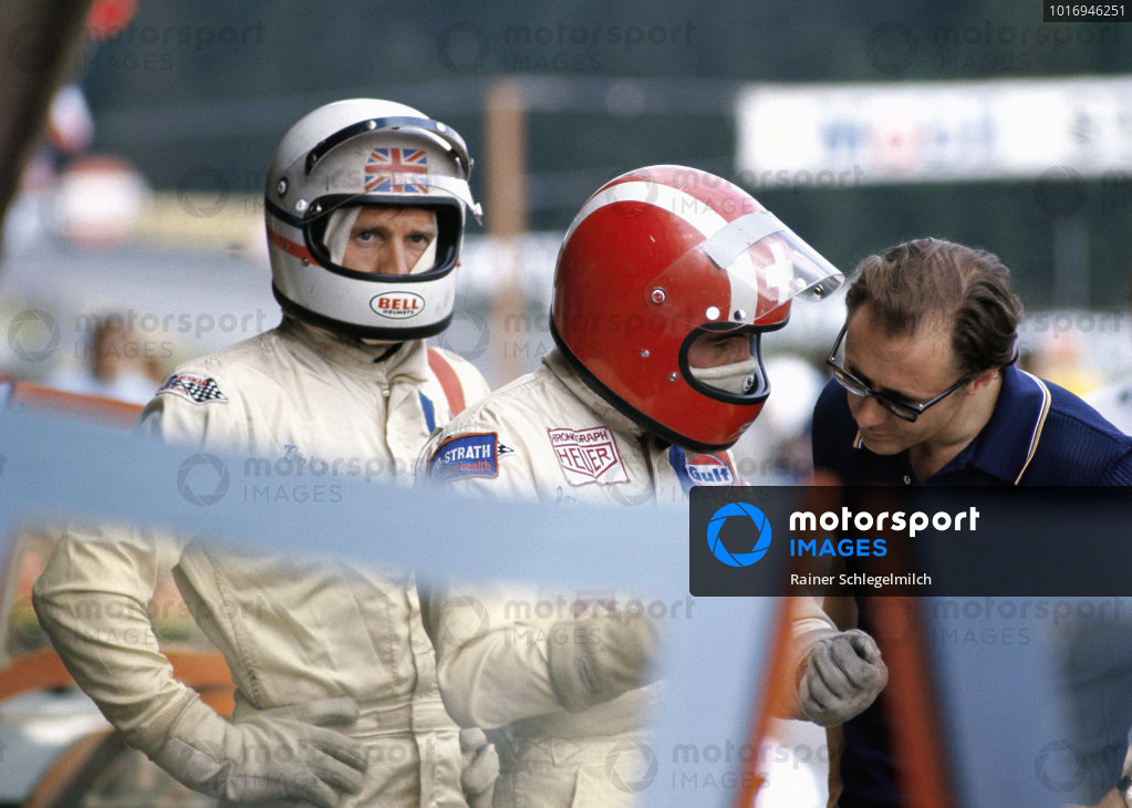 Jo Siffert and Derek Bell in the pitlane.