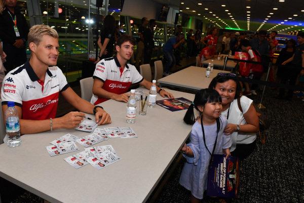Marcus Ericsson, Alfa Romeo Sauber F1 Team and Charles Leclerc, Alfa Romeo Sauber F1 Team at the fans autograph session