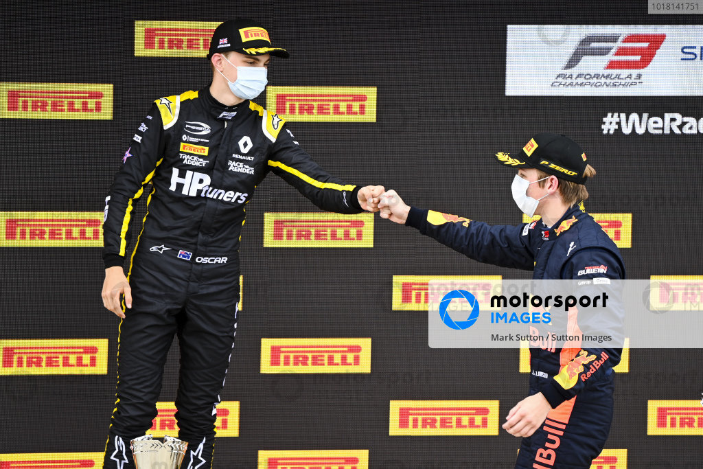 Race winner Liam Lawson (NZL, HITECH GRAND PRIX) celebrates on the podium with Oscar Piastri (AUS, PREMA RACING)